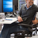 A PDT employee leaning from his seat
